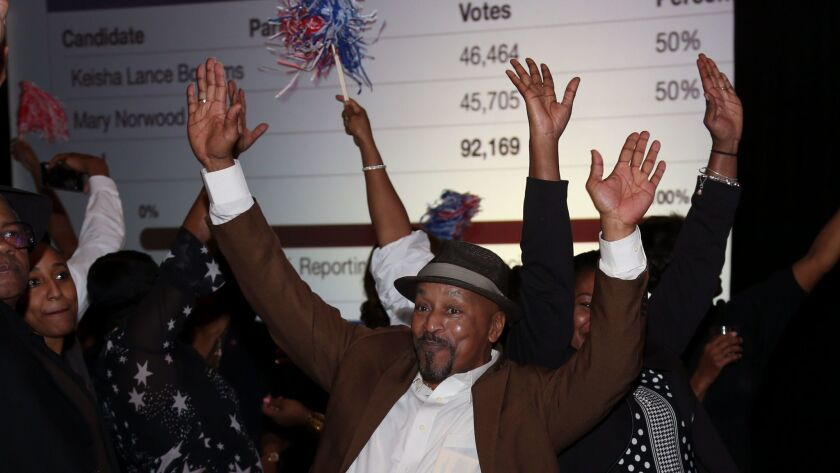 Supporters of Atlanta mayoral candidate Keisha Lance Bottoms celebrate during an election night watch party. Bottoms narrowly won the initially tally; a recount might take several days to complete.