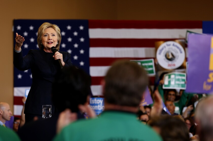 Hillary Clinton speaks to a crowd at Painters Hall in Henderson, Nev.