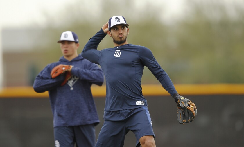 San Diego Padres Javier Guerra fields the ball during spring training in Peoria on Feb. 14, 2018.