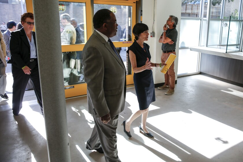 L.A. County Supervisor Mark Ridley-Thomas gets a tour of the new Downtown Mental Health Center on Monday. Supervisors voted on Tuesday to merge three departments that deal with physical and mental health and broader public health issues into a single department.