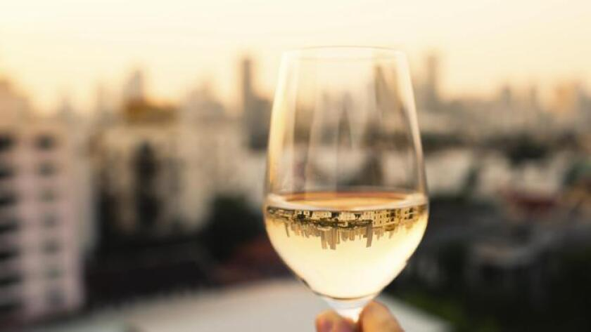 Woman enjoying glass of wine in the city. (Getty Images/iStockphoto)