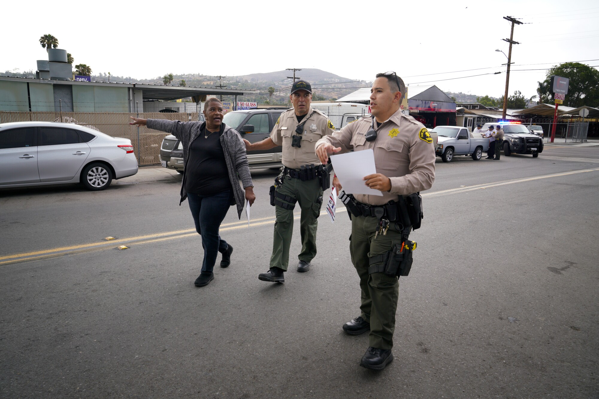 San Diego Sheriff's deputies and volunteers walked the nearby neighborhood in Spring Valley distributing a flyer