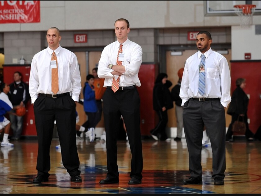 Todd Wolfson, center, and Nick Halic, right, used to coach together at Chaminade in 2009. Now they'll be facing off Thursday when St. Francis hosts Birmingham. At left is Mike Dulaney.