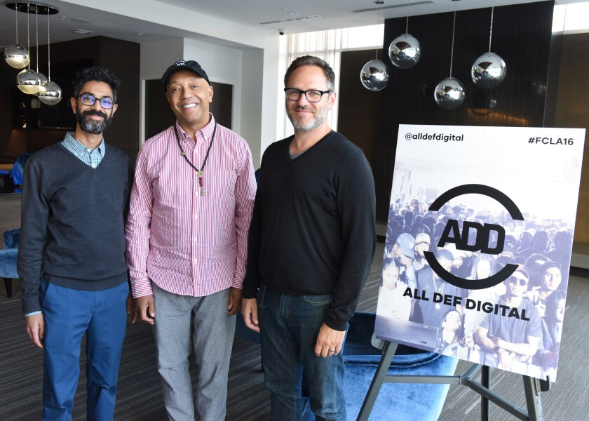 From left, All Def Digital President and chief executive Sanjay Sharma, founder Russell Simmons and ADHD Managing Director Josh Mandel at a conference in L.A. in May.