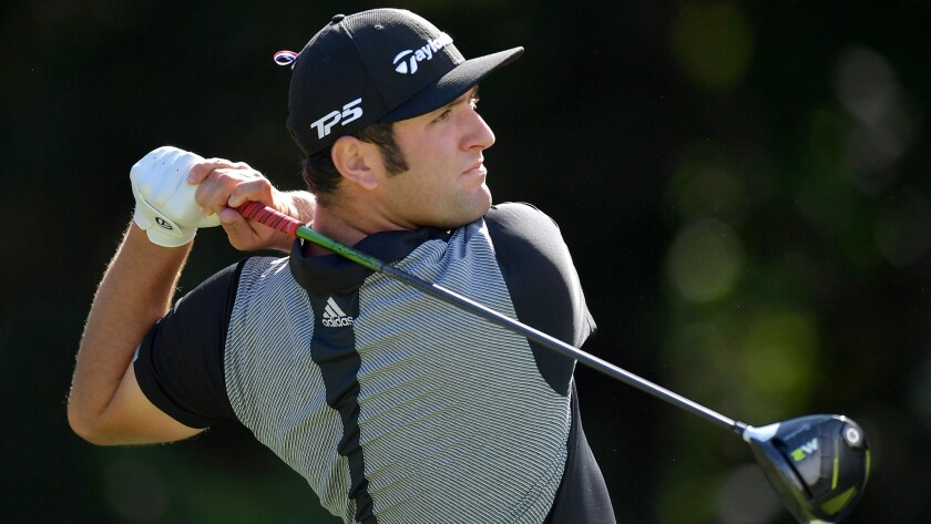 Jon Rahm follows through on his tee shot at No. 14 during the third round of the Dell Technologies C