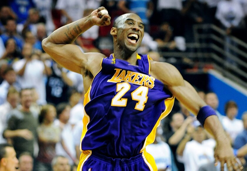 Kobe Bryant celebrates after the Lakers defeated the Orlando Magic in Game Five of the 2009 NBA Finals. Bryant was one of nine people who died in a helicopter crash Sunday morning in Calabasas.