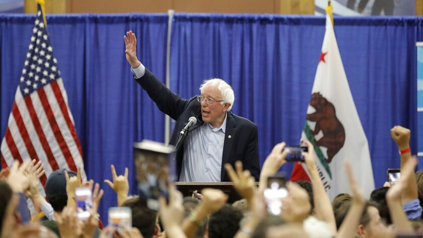 Sen. Bernie Sanders speaks to a crowd at MiraCosta College in Oceanside on Friday night as he stumps for Democratic candidates running for seats in the midterm election.