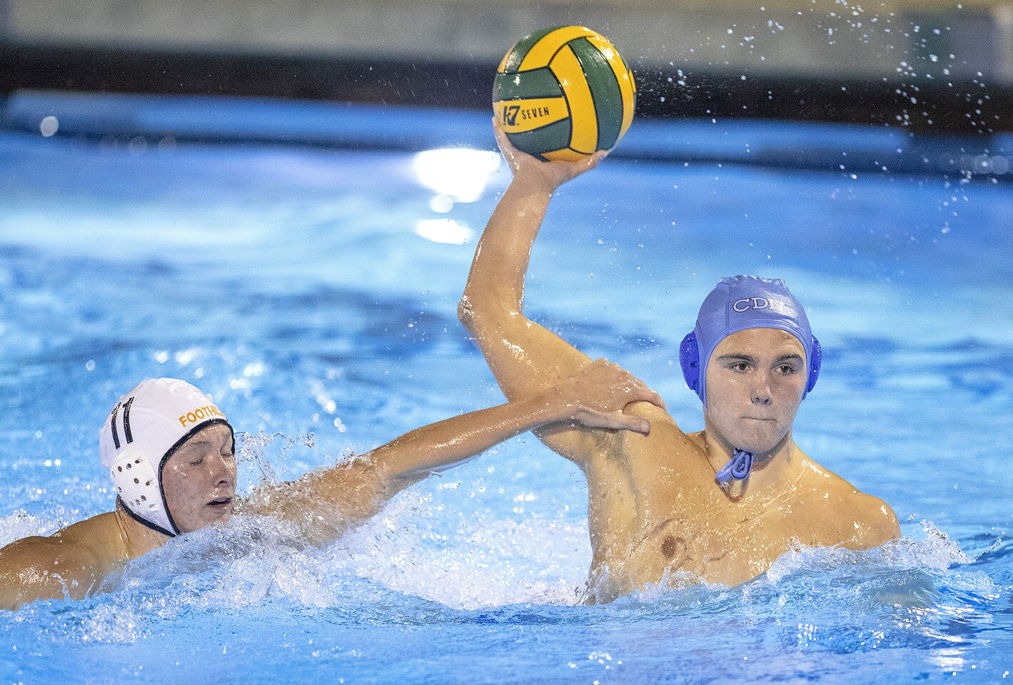 Corona del Mar's Tanner Pulice gets pressure from Foothill's Noah Rowe during a CIF Southern Section Division 2 playoff game at Woollett Aquatic Center on Wednesday, November 7.