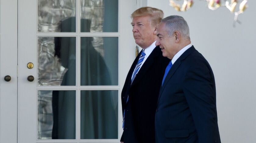 President Trump and Israel Prime Minister Benjamin Netanyahu walk outside the White House in March. Their closeness seems to have bolstered Netanyahu's confidence.