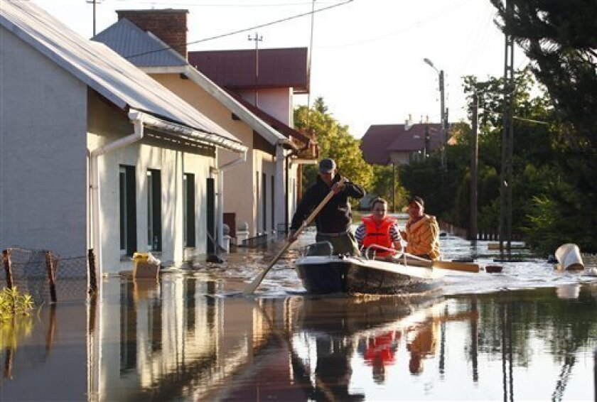 Firefighters evacuate residents from flooded houses in Mielec, southern Poland, where the Wisloka River has reached unusually high levels on Saturday, June 5, 2010.(AP Photo/Krzysztof Lokaj)