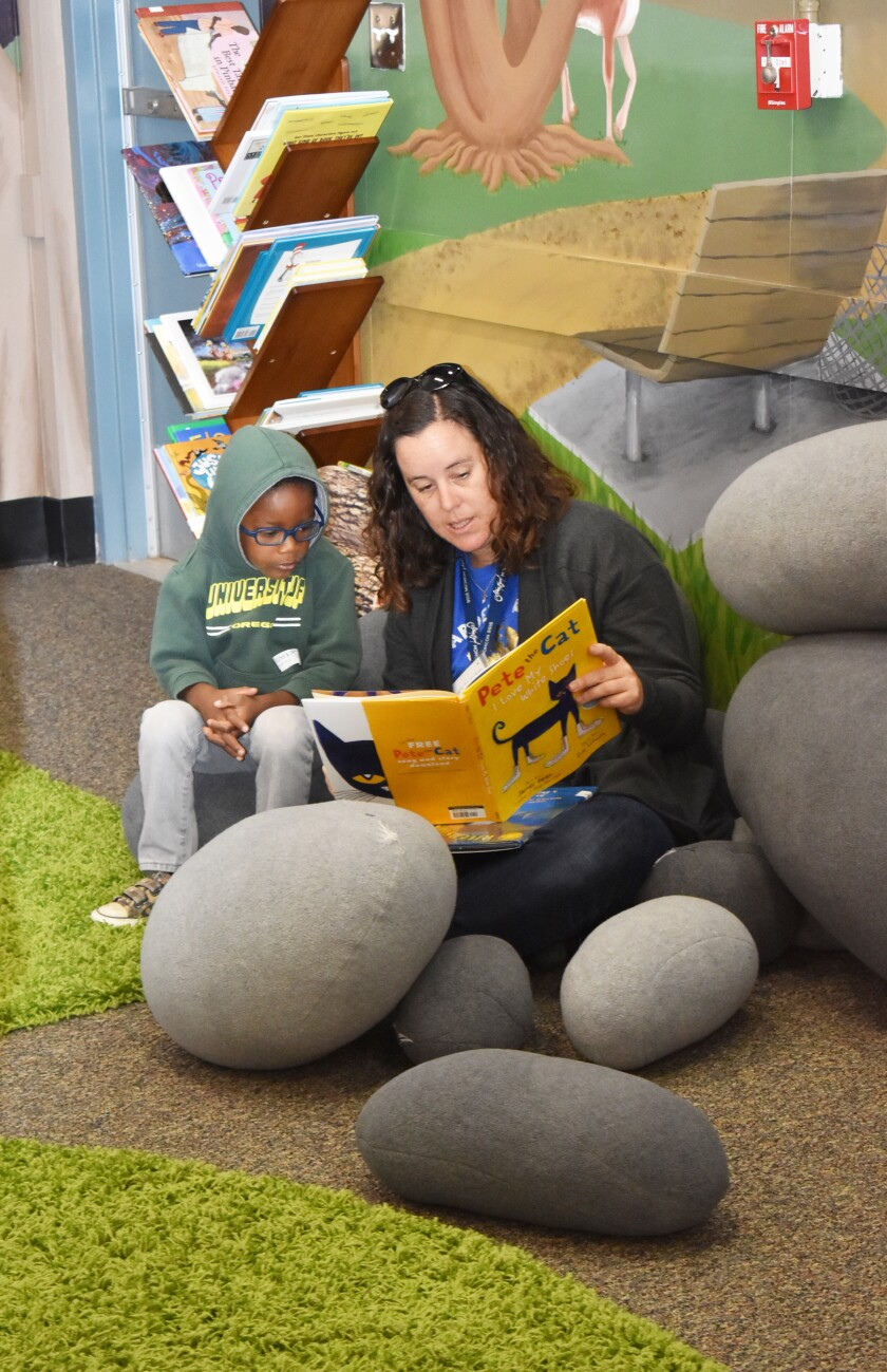 David and Corinne Rocha read together on the rock pillows in the new reading room.