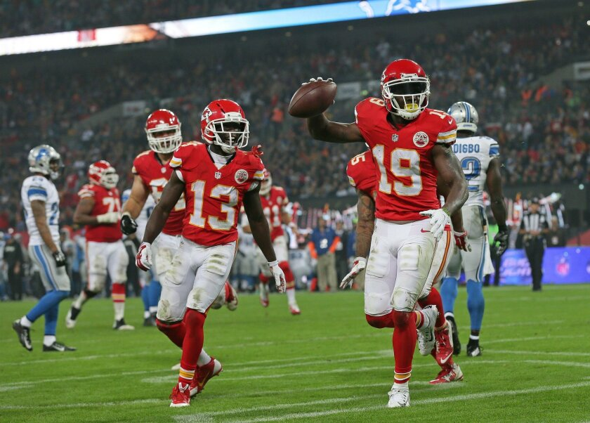 Kansas City Chiefs wide receiver Jeremy Maclin (19), right, reacts after scoring a touchdown during the NFL football game between Detroit Lions and Kansas City Chiefs Wembley Stadium in London,  Sunday, Nov. 1, 2015. (AP Photo/Tim Ireland)