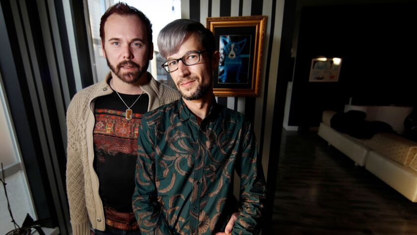 Charlie Craig and David Mullins in their home in Denver on Nov. 28. On Dec. 5, the Supreme Court will hear arguments about a baker who refused to make a cake for the couple's wedding.