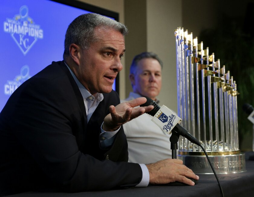 Kansas City Royals general manager Dayton Moore, left, and manager Ned Yost speak to members of the media with their World Series trophy during a news conference wrapping up the team's season Thursday, Nov. 5, 2015, in Kansas City, Mo. The Royals capped their season by defeating the New York Mets i