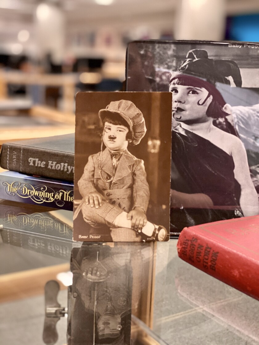 UCSD's Geisel Library exhibit, 'Diana Serra Cary: The Last Living Silent Film Star,' includes photos of Baby Peggy from her films, as well as books she authored after her retirement from the university.