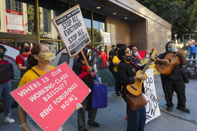 Tenants and housing rights organizers rally at Stanley Mosk Courthouse in Los Angeles to protest eviction orders.