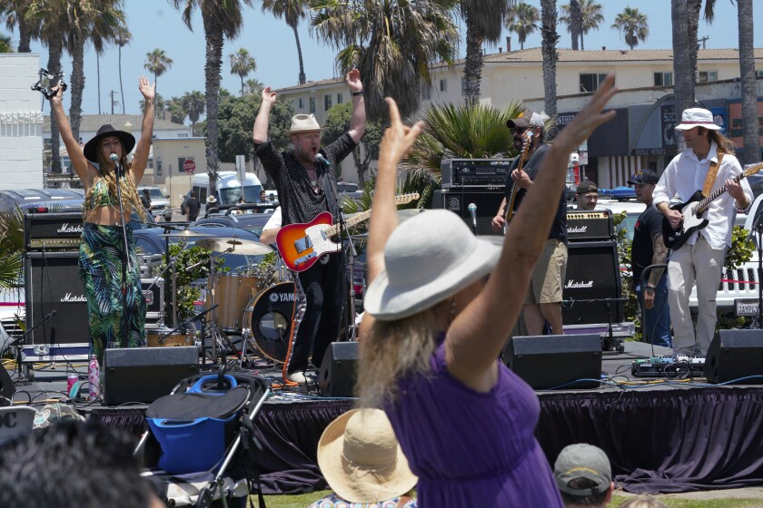 Band Brian Jones Rock 'n' Roll Revival plays to a crowd Saturday at the Celebrate the OB Vibe festival.