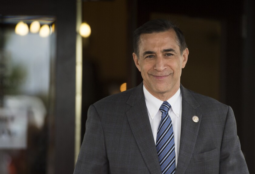 Darrell Issa leaves the House Republican Conference meeting in Washington.