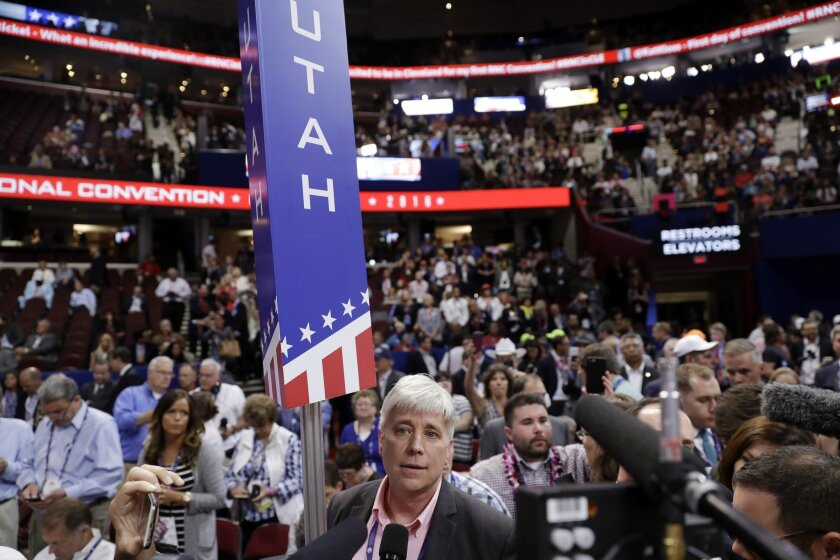 Utah delegate Phil Wright speaks as some delegates call for a roll call vote on the adoption of the rules during the opening day of the Republican National Convention in Cleveland, Monday, July 18, 2016. (AP Photo/Matt Rourke)