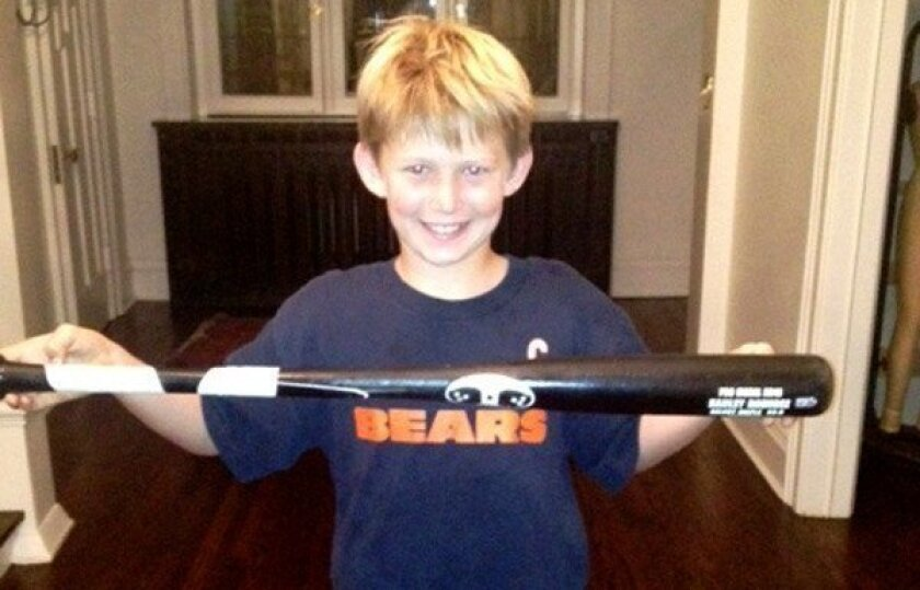 Jack Baur displays his Hanley Ramirez-autographed bat.