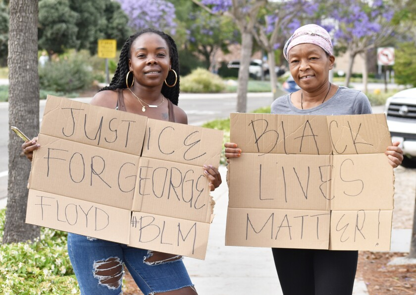 4S Ranch residents Linda Jackson and her mother, Mary Jackson holding protest signs that include black lives matter.