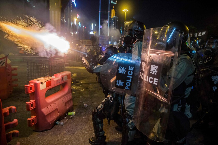 Police fire tear gas during a protest Aug. 4 in Hong Kong's Causeway Bay district.