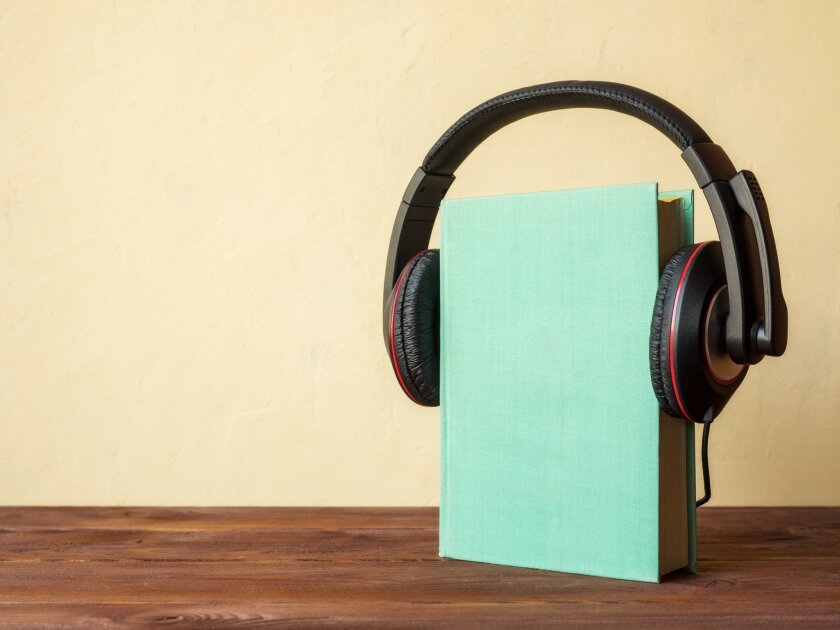 Book upright on table seeming to wear headphones