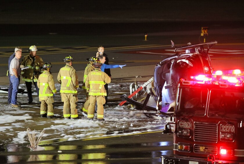 At Palomar Airport emergency personnel investigate the scene of a helicopter wreck.