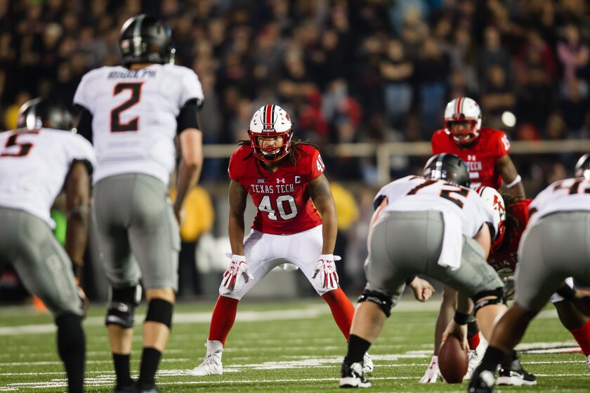 Dakota Allen gets in defensive position playing for Texas Tech.