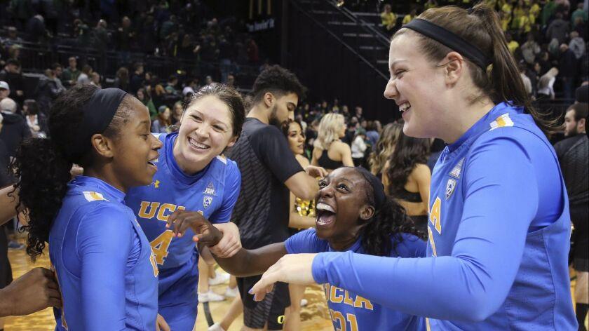 UCLA's Japreece Dean, left, Lindsey Corsaro, Michaela Onyenwere and Chrissy Baird celebrate after a 74-69 win over Oregon on Feb. 22.