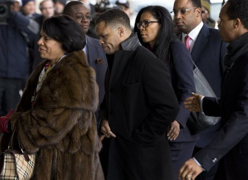 Former Illinois Rep. Jesse Jackson Jr., center, arrives at the E. Barrett Prettyman Federal Courthouse in Washington, Wednesday, Feb. 20, 2013. Jackson and his wife were to appear in federal court to answer criminal charges that they engaged in an alleged scheme to spend $750,000 in campaign funds
