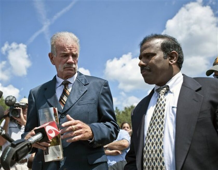 Pastor Terry Jones, left, of the Dove World Outreach Center introduces A.K. Paul, president of Global Peace Initiatives in Houston, to the media in Gainesville ,Fla., Friday, Sept. 10, 2010, (AP Photo/Phil Sandlin)