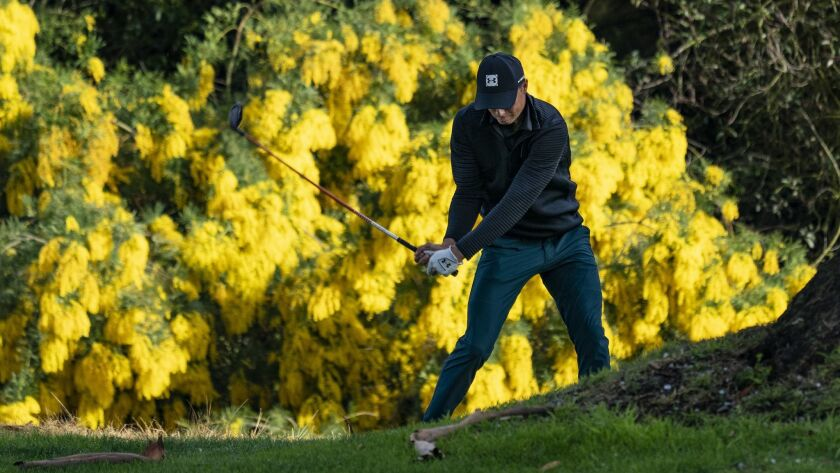 Co-leader Jordan Spieth hits out of the rough on the 13th hole during the first round of the Genesis Open at Riviera Country Club.