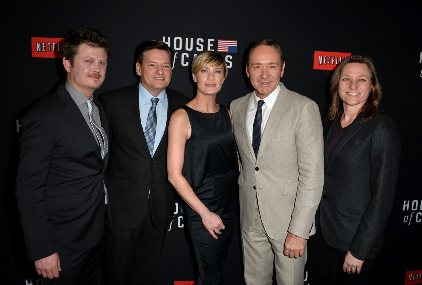 """Netflix and Comcast have reached an agreement that will ensure subscribers to the online video service will receive seamless access to TV shows and movies, like the original series """"House of Cards."""" The second season of the political thriller debuted on Valentine's Day. From left, writer Beau Willimon, Netflix chief content officer Ted Sarandos, actress Robin Wright, executive producer/actor Kevin Spacey and Netflix vice president for original series Cindy Holland arrive at the special screening at the Directors Guild of America in Los Angeles."""