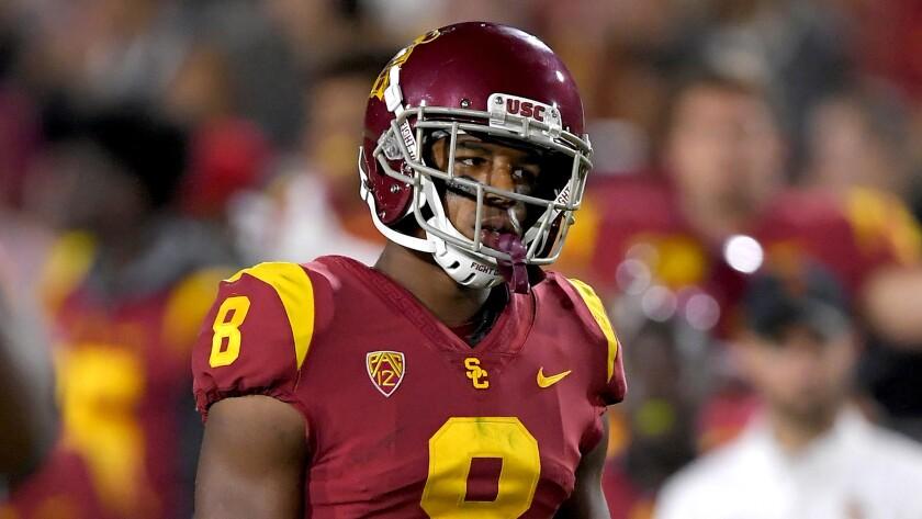 USC cornerback Iman Marshall played high school football at Long Beach Poly with UCLA receiver Christian Pabico.