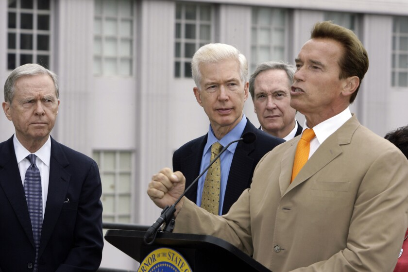 California Gov. Arnold Schwarzenegger, right, speaks as former Govs. Pete Wilson, left, and Gray Davis look on at an August 2007 news conference on redistricting.