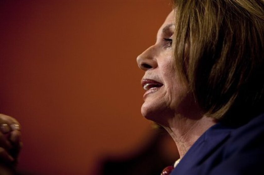 House Speaker Pelosi of Calif. takes part in her weekly news conference on Capitol Hill in Washington, Thursday, Oct. 8, 2009. (AP Photo/Evan Vucci)