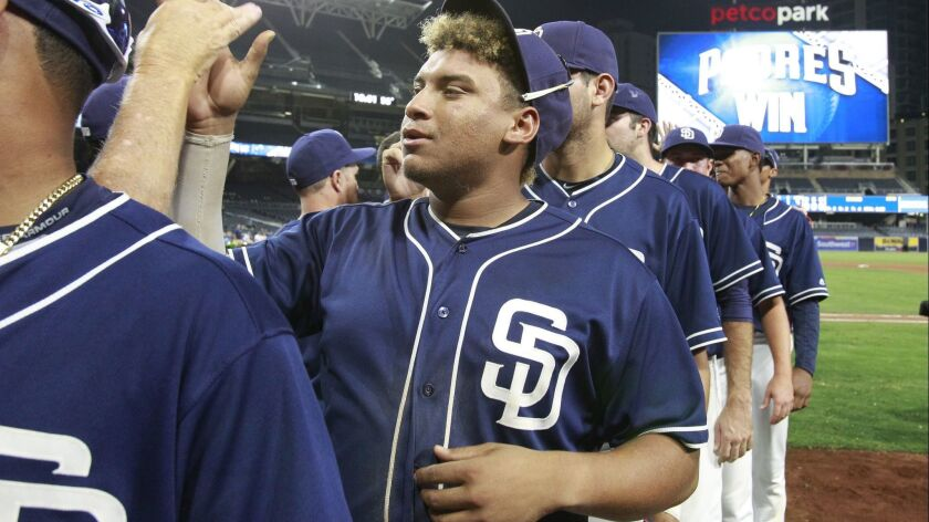 The Padres' Josh Naylor high fives teammates after the Padres beat the Texas Rangers during the Padres Futures Game at Petco Park on Friday, Oct. 7, 2016.