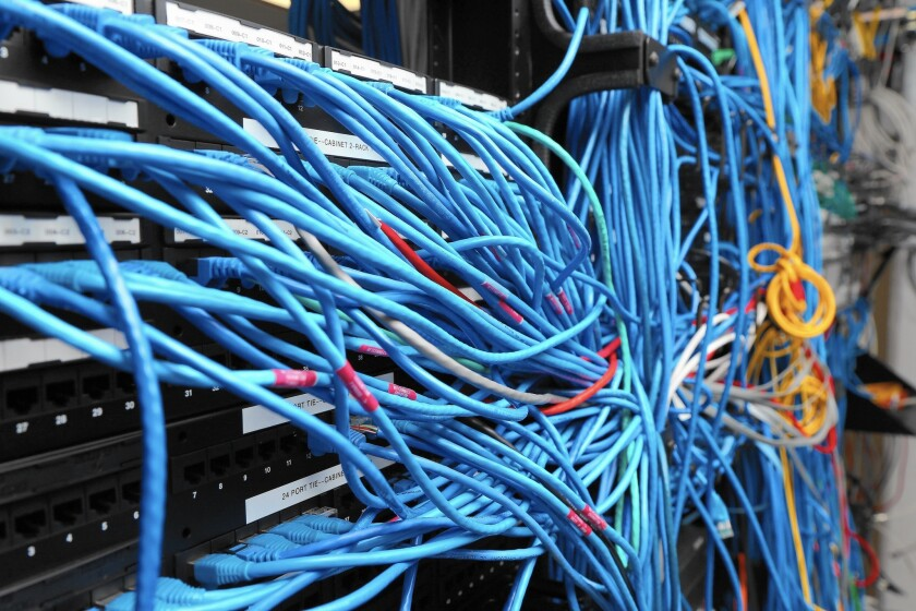 What the FCC has done is reclassify the Internet as a telecommunications service, rather than its former designation as an information service. Above, network cables are plugged into a server room.