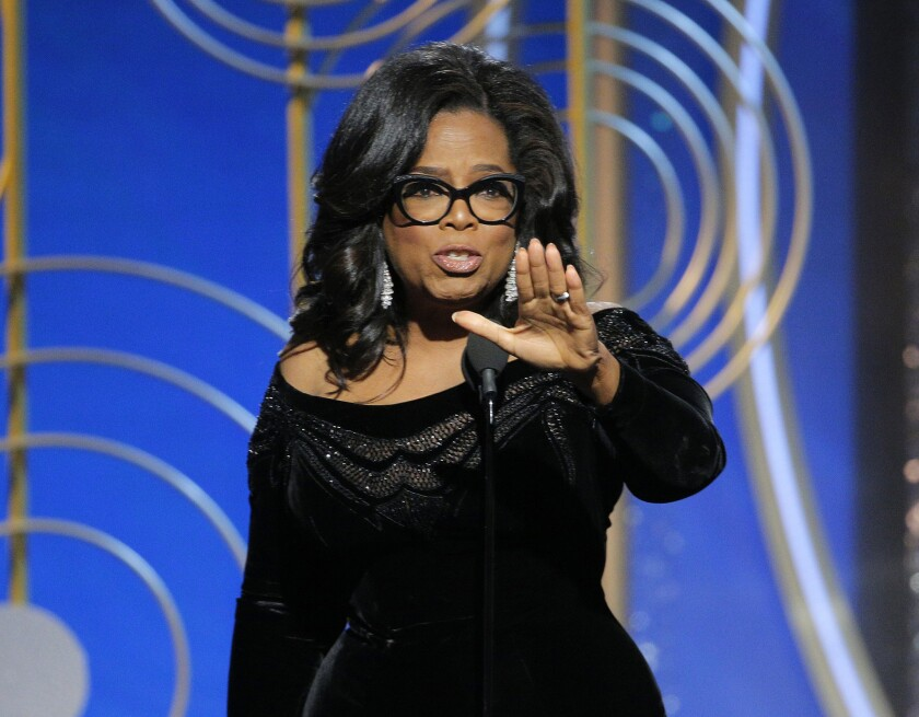 This image released by NBC shows Oprah Winfrey accepting the Cecil B. DeMille Award at the 75th Annu
