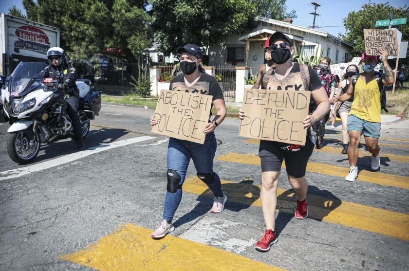 Demonstrators march down Landis Street in City Heights