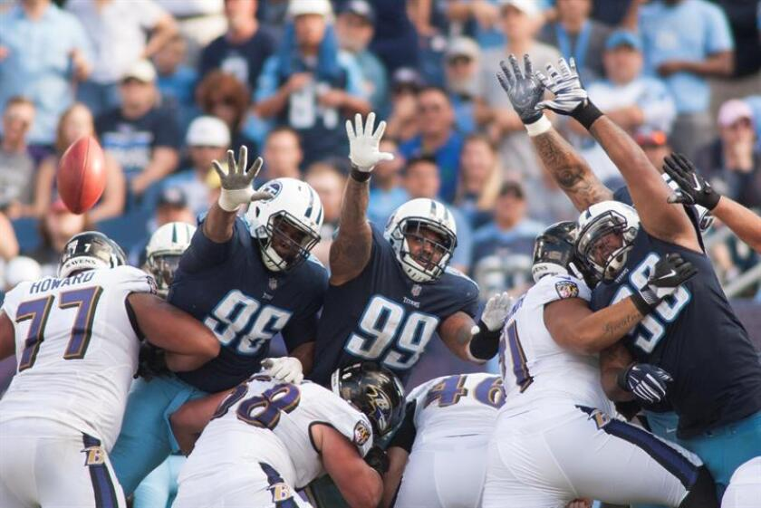Tennessee Titans nose tackle Sylvester Williams, 96,Tennessee Titans defensive end Jurrell Casey, 99,and Tennessee Titans outside linebacker Brian Orakpo, 98, try to block a field goal kick, but the Ravens scored in their NFL game at Nissan Stadium in Nashville, Tennessee, USA, 05 November, 2017. EFE-EPA/RICK MUSACCHIO