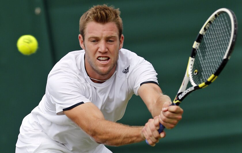 FILE - In this June 26, 2014, file photo, Jack Sock, of the United States, returns a shot to Milos Raonic, of Canada, during their men's singles match at the All England Lawn Tennis Championships at Wimbledon, London, England. Which of the younger set in men's tennis might make a statement this yea