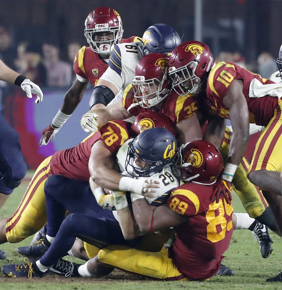 The USC defense clamps down on Cal running back Patrick Laird in the fourth quarter.