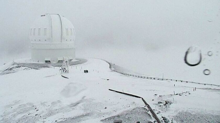 The summit of Mauna Kea on Hawaii's Big Island is covered in snow on Dec. 1, as seen in an image from webcam video provided by Canada-France-Hawaii Telescope.