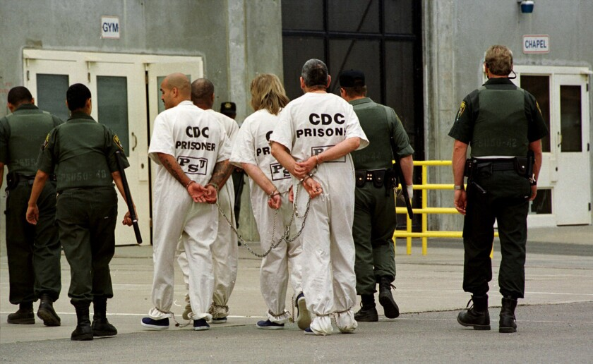 FILE — In this Oct. 28, 1999, file photo a group of inmates is moved from one cell unit to another at California State Prison Sacramento, in Folsom, Calif. California prison guard Sgt. Kevin Steele, 56, killed himself after reporting corruption and harassment at the prison to authorities and cooperating with attorneys suing the state according to the Sacramento Bee, Wednesday, Oct. 6, 2021. (AP Photo/Rich Pedroncelli, File)