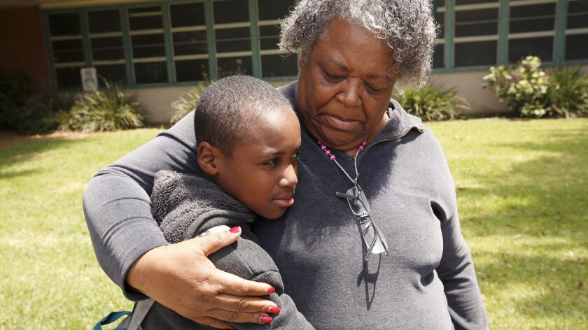Annie Hall, right, wth her son Deartonne Graves, 11, a sixth-grade student at Daniel Webster Middle