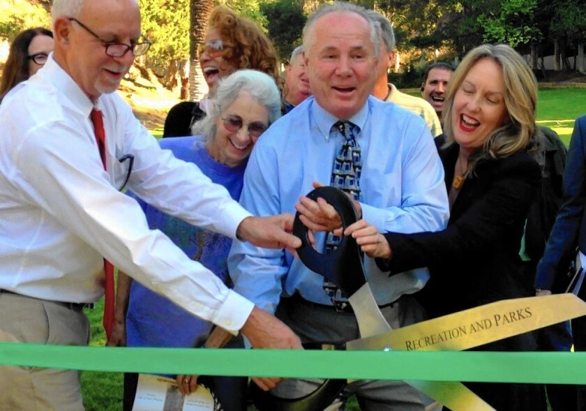 Times columnist Steve Lopez, left, helps at a ribbon-cutting with City Councilman Tom LaBonge as they trade places for a day at the dedication of Wattles Park in October 2013.