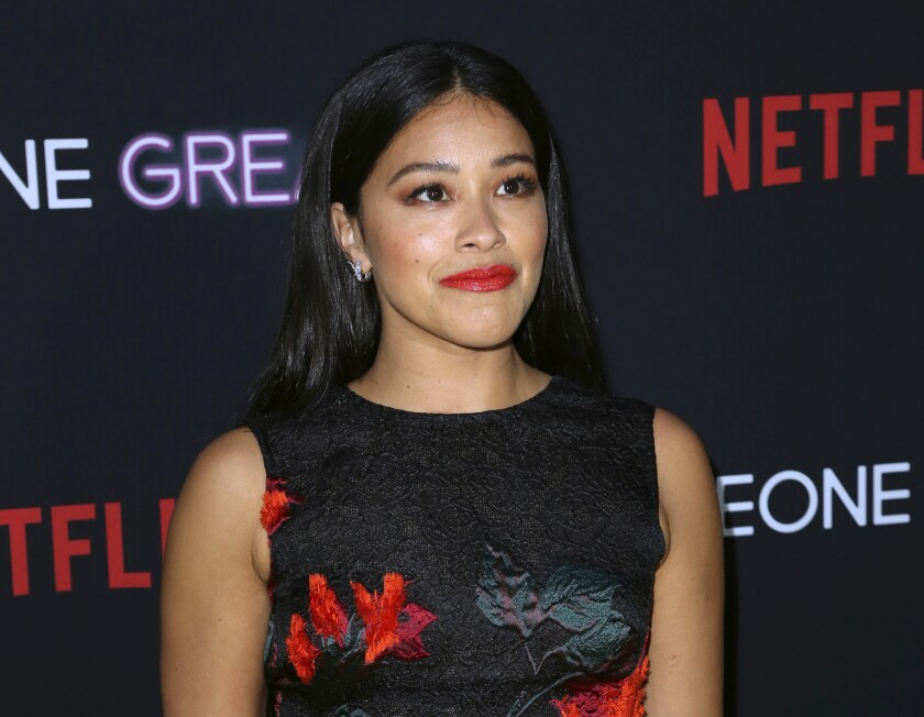 "FILE - This April 17, 2019 file photo shows Gina Rodriguez at a special screening of ""Someone Great"" in Los Angeles. Rodriguez has apologized for singing along on her Instagram Story to a Lauryn Hill verse that includes the N-word. The ""Jane the Virgin"" actress deleted the short video she posted Tuesday and replaced it with her apology, but not before memes and other backlash ensued. Rodriguez said in her apology she's a longtime Fugees and Hill fan and didn't mean to offend anyone. (Photo by Willy Sanjuan/Invision/AP, File)"