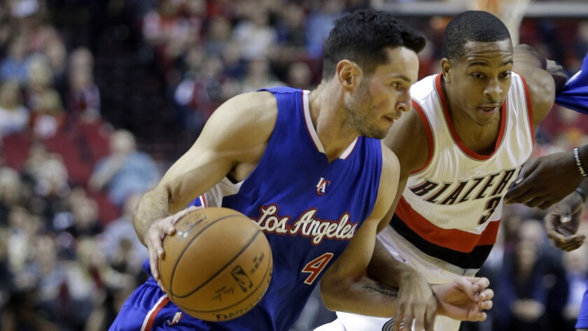 Clippers guard J.J. Redick, left, drives past Portland Trail Blazers guard CJ McCollum during the first half of a preseason game on Oct. 12.